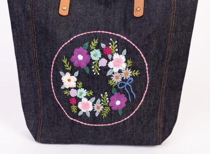 Floral hand embroidered tote bag