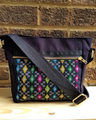 Crossbody bag with handloom tribal motif